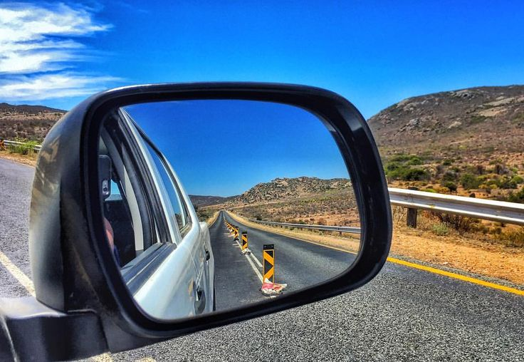 Photo by @manablazemick • side mirror shot · rear view · looking back · mountains · road trip · travel · South Africa · rural · photography · traffic · transport · landscapes