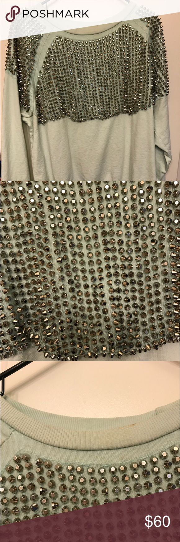 Mint green studded sweater from H&M This sweater has some stains around the collar, before shipping out I will attempt to get those out but I'm not sure if it's possible, please let me know if you have questions, the sweater itself is light weight material but the studs are super heavy H&M Sweaters