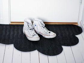 Update a cheap floor mat by cutting out a cloud design