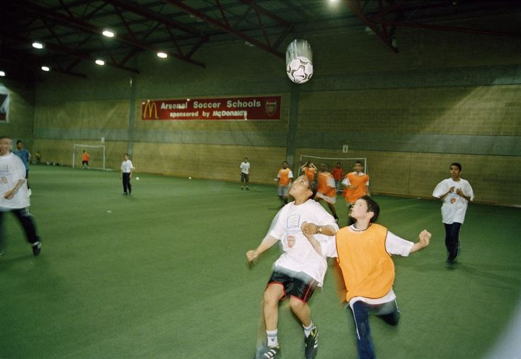 Magnum Photos -  Chris Steele-Perkins  G.B. ENGLAND. London. The Arsenal Football Ground in Highbury is the location for a football training course for children from London, organised by the Maimonides Foundation and Arsenal Football Club to promote Muslim Jewish Friendship between the children. 2003.