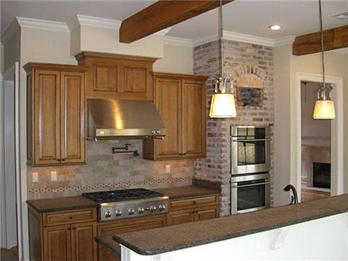 Double Oven Built Into The Brick Wall Surround In This