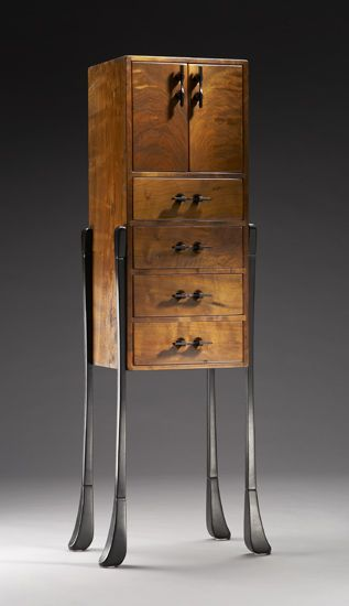 Sterling by Brian Hubel. Japanese influenced cabinet with ebonized ash legs contrasting beautifully against the Claro walnut cabinet with *bookmatched* doors. Shellac finish enhances the rich grain and color.
