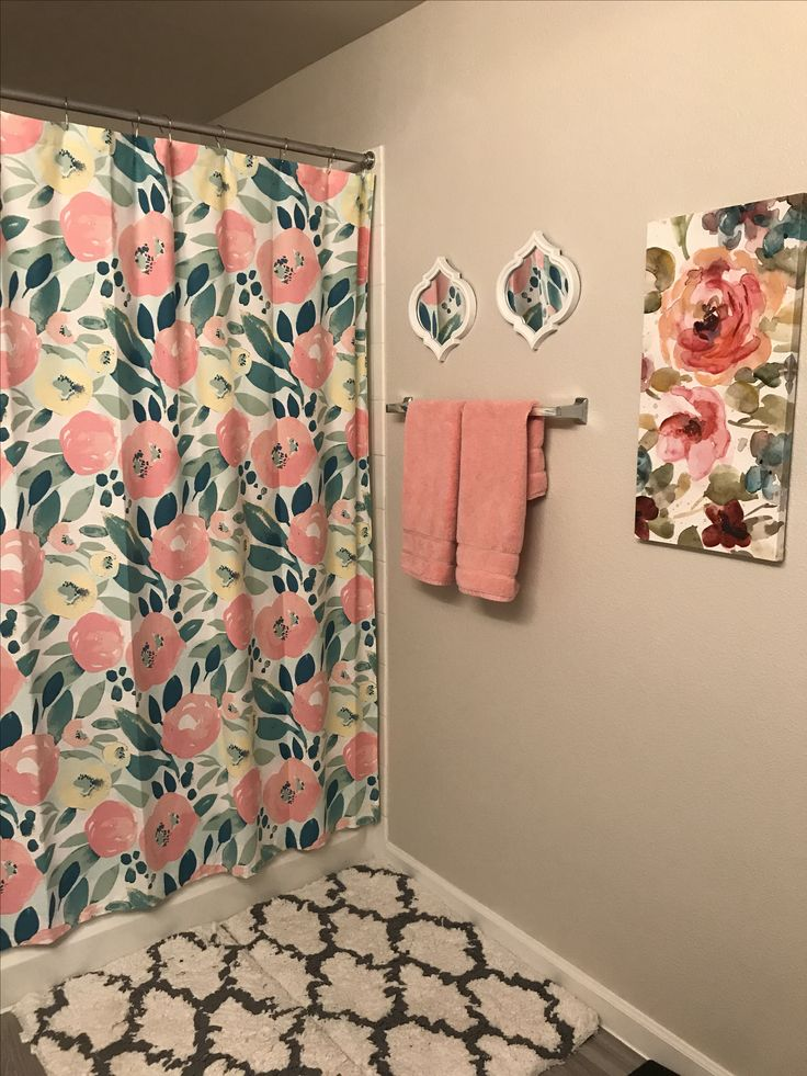 Bathroom decor. Pink, floral, small mirrors, pink hand towels, plush shower rug/mat