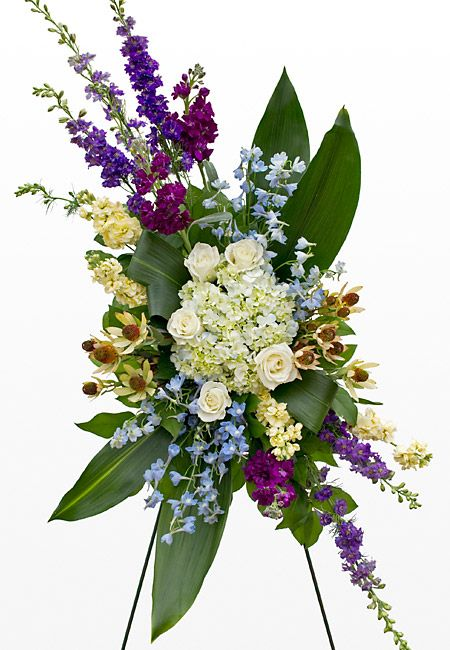 Unique Funeral Flowers | Purple, white, and green funeral standing spray.