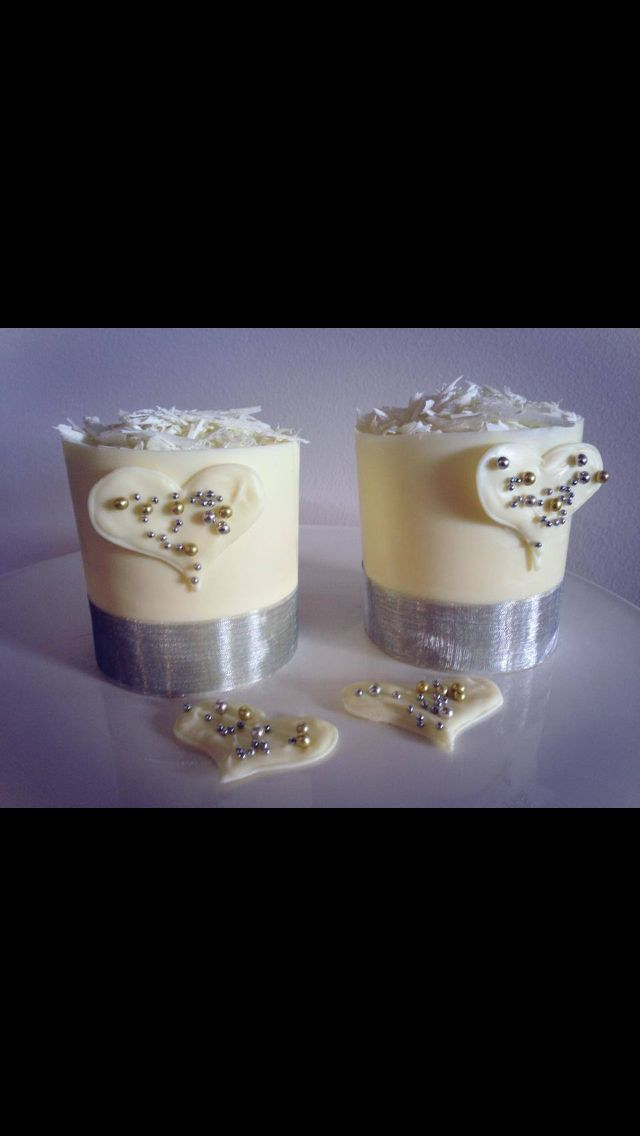 White chocolate cup cupcakes with chocolate collars, white chocolate love hearts & silver pearls, for weddings or an engagement party.
