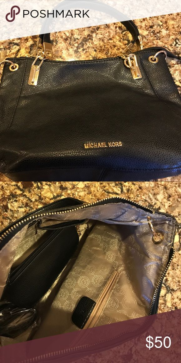Black Michael Kors Shoulder Bag with coin purse. Never been used black Michael Kors bag. Very roomy with a matching coin purse. Michael Kors Bags Shoulder Bags