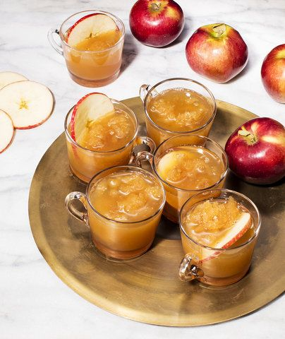 "Boozy Apple Cider Slushie | This fall is especially warm, right? Or are we just making excuses to drink this spiked apple cider slushie? Either way, this frozen cocktail is a seasonal stunner. You make a boozy granita using a mixture of bourbon, apple cider, and a super easy spiced brown-sugar syrup. Then you freeze and scrape, freeze and scrape until you reach, er, ""slushie"" texture (you know what we mean). It's pretty garnished with a slice of apple but cinnamon sticks would add another…"