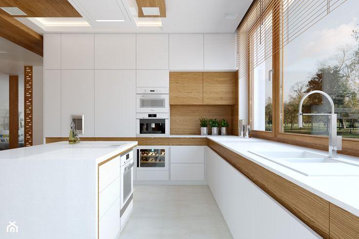 biały blat kuchenny, brązowe żaluzje, nowoczesna kuchnia