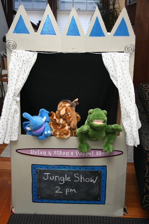 who doesn't love a good puppet show .. theater out of cardboard box.