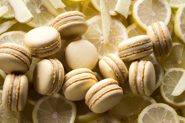 Macarons with white Valrhona chocolate ganache, lemon juice and ginger.