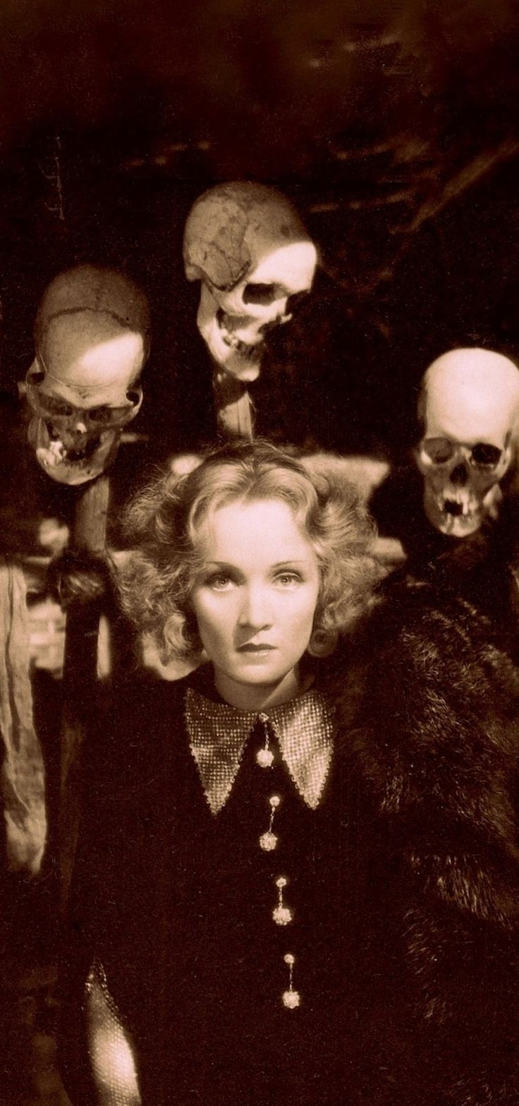 MARLENE DIETRICH & skulls 1932) SHANGHAI EXPRESS. Was 1932's highest-grossing film, & won the Oscar for Best Cinematography. Photo (detail) by Don English. Costumes by Travis Banton. From Marlene Dietrich Portraits 1926-1960 Intro by Klaus-Jürgen Sembach (1984)