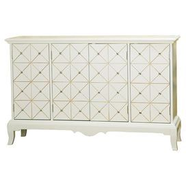 "An elegant addition to your entryway or dining room, this stylish sideboard features jeweled doors and a sea green-hued interior.   Product: Sideboard  Construction Material: Wood and metalColor: White  Features:  Three adjustable shelves  Geometric paneling Four doors   Dimensions: 39"" H x 59.5"" W x 18.25"" D"