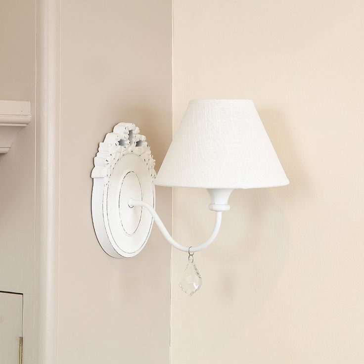 Add some timeless french style to your home with this ornate wall light the wall mount is made from wood that is oval in shape with a deliberate