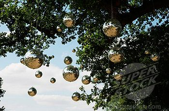 Secret Garden Wedding Theme: Ideas? :  wedding garden secret garden wedding vintage whimsical  08012203 © PYMCA) Disco Mirror balls hang from a tree; The Secret Garden Party Festival ; Huntingdon Cambridgshire; UK; August 2005 (4062-2392 / 08012203 © PYMCA)