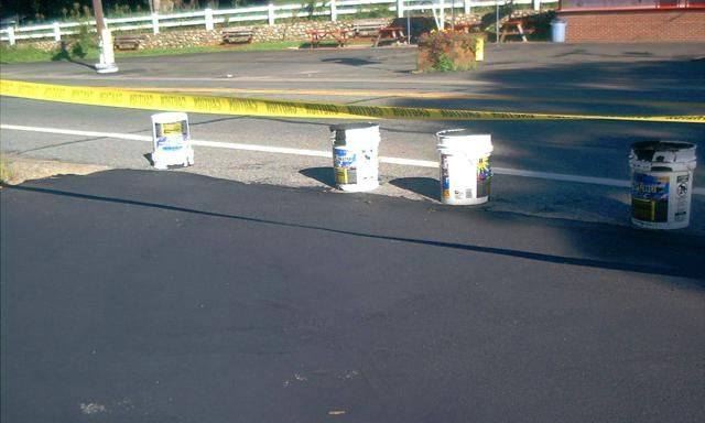 Keep Your Asphalt Driveway in Tip-Top Shape: Place barricade tape across your newly-sealed driveway to protect it.