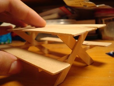 miniature picnic table made from sticks and glue