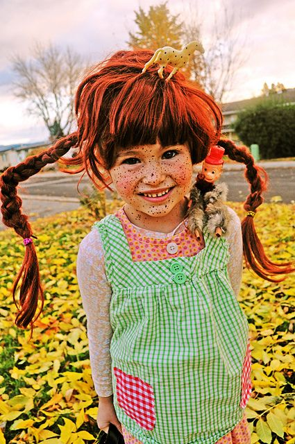 OMG...Again....I totally made my daughter, Pam, a Pippi Longstockings costume like this when she was little.  I braided pipe cleaners into her braids to make them stick out!~