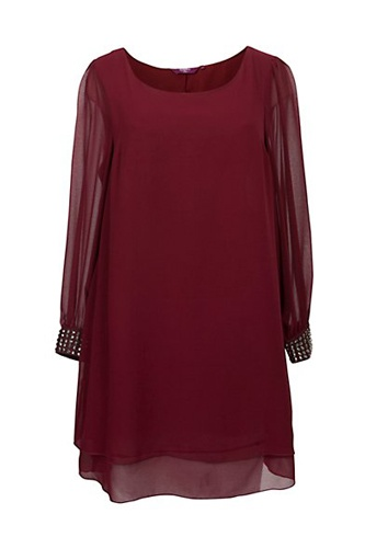 Love this oxblood tunic. The studded wrist make it fancy enough for a fun night out. Id personally pair it with sheer black leggings and stiletto combat boots.