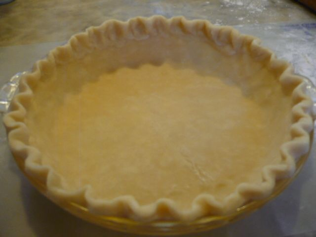Basic Pie Crust, with Coconut Oil instead of shortening...I made this in my food processor and it was the easiest pie crust I have ever made. And it rolled out easily also.