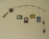 I could so make this DIY fly fishing picture hanger!