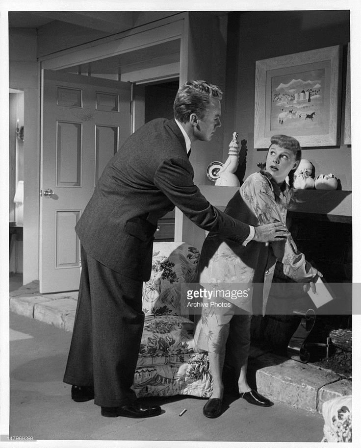 June Allyson throws away every cigarette in Van Johnson's house in a scene from the film 'Too Young To Kiss', 1951.