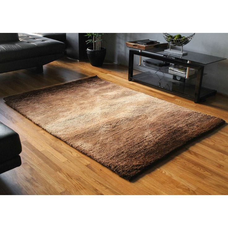 Add a splash of stunning style and comfort to your home decor with this shag rug.  This rug features a striking and contemporary 'fading light' design, a thick, plush polyester pile contruction, and is available in three beautiful color variations.