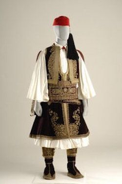 Otto, the first king of Greece established this urban costume as the formal Court attire in around 1835. Originally the uniform of the Greek Revolutionary chieftains, it is characterized by the long (below-the-knee) foustanella, and the silk tourbani that was usually wrapped and tied around the fez.