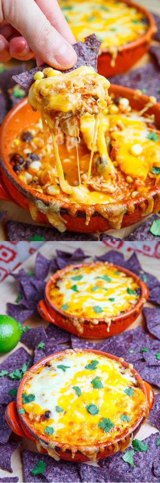 Cheesy Chicken Enchilada Dip Recipe | Cinco de Mayo Appetizer Recipes by DIY Ready at http://diyready.com/23-cinco-de-mayo-recipes-to-get-the-party-started/
