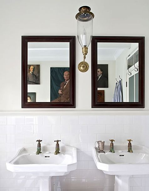 love the subway tile and portraits