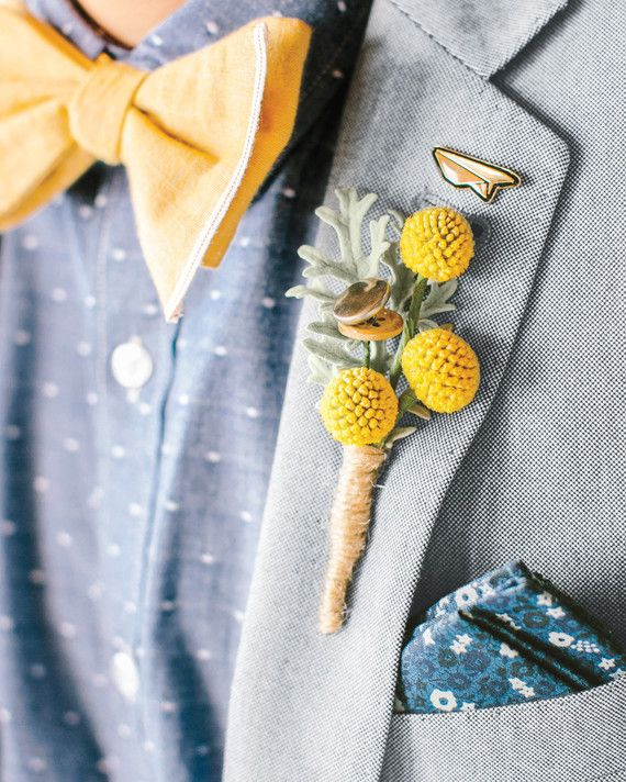 Billy balls, dusty miller, and handmade button flowers tied with twine dressed up Matt's lapel.