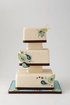 Beautiful buttercream cake with paisley accents - blue, green, yellow, brown, and aqua by Lulu Cake Boutique in New York City (www.everythinglulu.com)