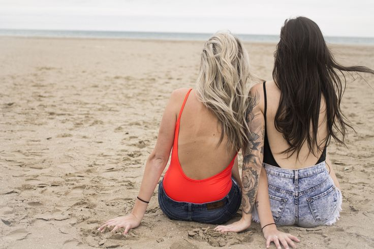 Coral and black low back bodysuit. Beach photoshoot for new Spring inventory