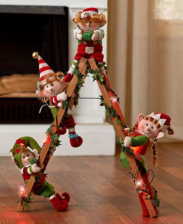 "The Lighted Decorative Ladder (16-1/2""W x 6-1/2""D x 24""H) lights up with slowly flashing red lights to put each elf on display. Requires 2 ""AA"" batteries. Polye"
