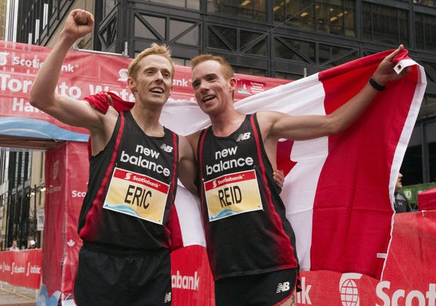 Eric Gillis and Reid Coolsaet together after they both qualified for the 2012 London Olympics