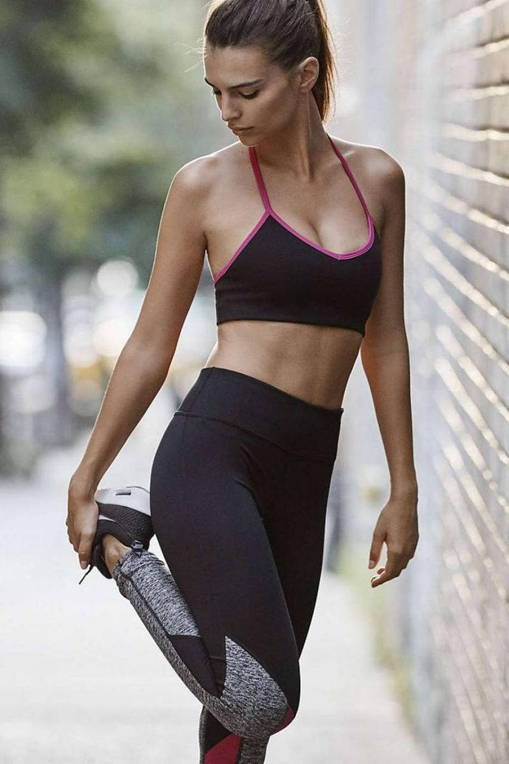 Emily Ratajkowski wearing Express Exp Core Strappy Back Sports Bra, Express Exp Core Marled and Berry Stripe Leggings and Nike Nike Air Max Motion Sneakers