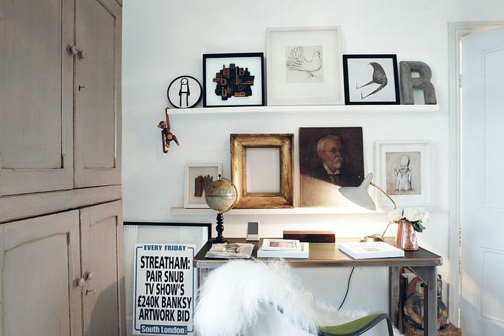 Throw in an empty frame to give the picture ledge a fun twist! [Design: Geraldine James / CICO Books]