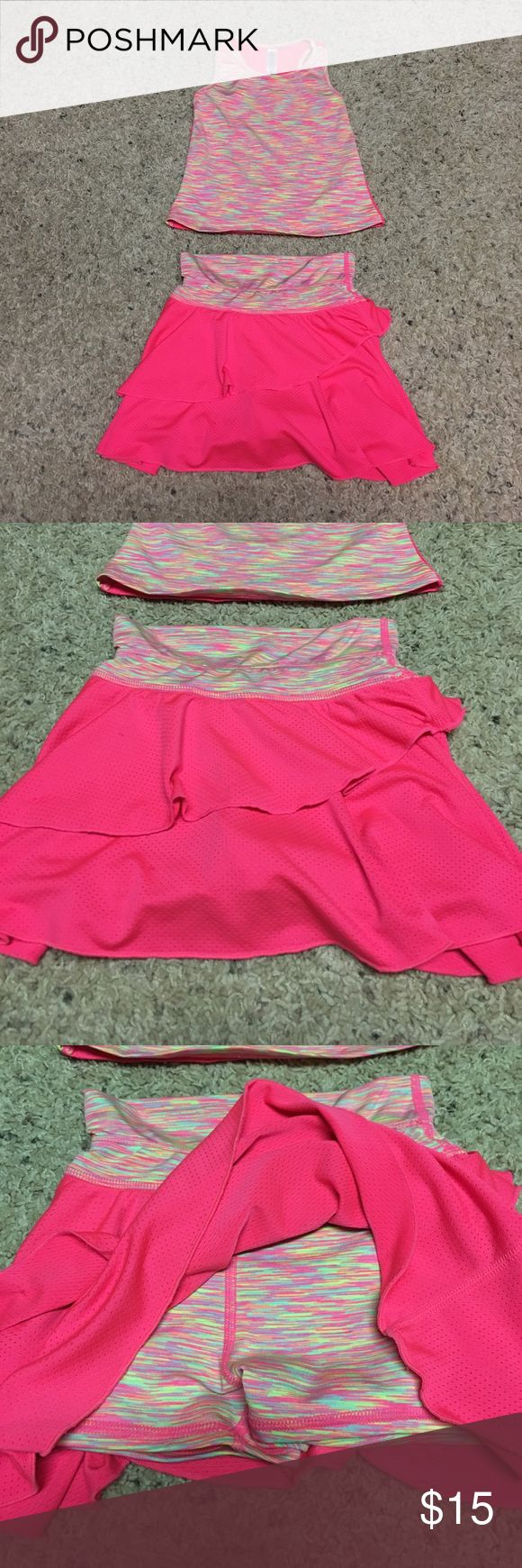 90 Degree by Reflex Baby 2pc skort set 3T Adorable hot pink skort with built in spandex shorts. Has 2 small ink spots on front that didn't come out in wash. Tank is multi-colored on front with neon yellow, pink, and orange that match skort material, has racer back with solid hot pink. Has small snag on back which is shown in picture. 90 Degree By Reflex Matching Sets