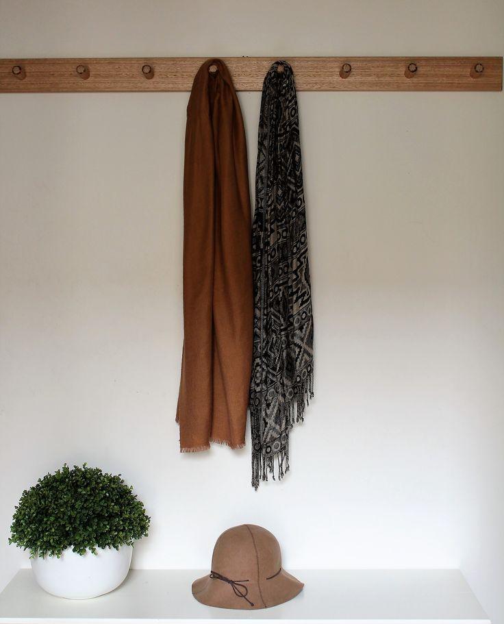 8 peg wooden coat rack.