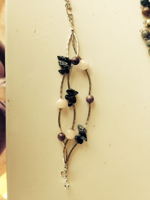 Pretty bracelet... rose quartz, sugilite and snowflake obsidian...