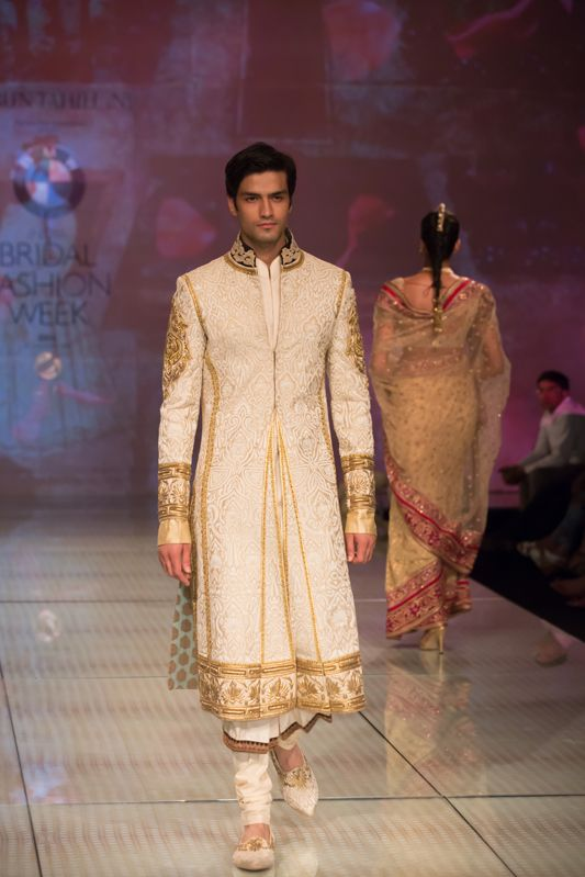 Tarun Tahiliani royal men's gold sherwani kurta. More here: http://www.indianweddingsite.com/bmw-india-bridal-fashion-week-ibfw-2014-tarun-tahiliani-show/