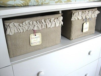 Cover random boxes with burlap, add ruffle embellishment. Cheaper than baskets.