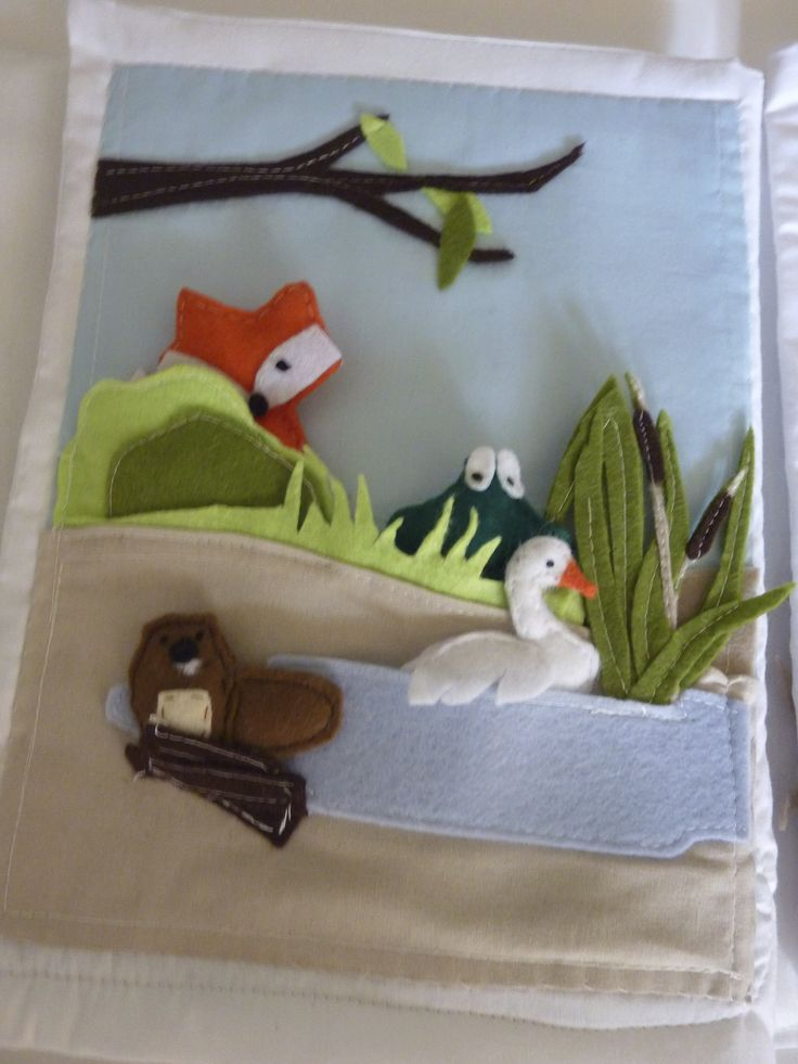 quiet book  countryside with pond and hidden felt animals.a fox,a frog a beaver and a swan.