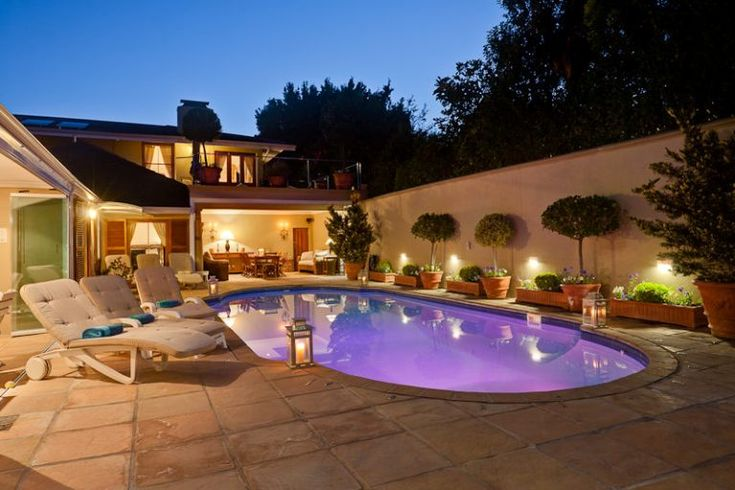 Le Bonheur - This home comprises top of the range Tuscan style self-catering villa. Home from Home, large elegant six bedrooms sleeps 12 and optional 14. This unique and up market home is situated within the Picturesque, ... #weekendgetaways #constantia #southafrica