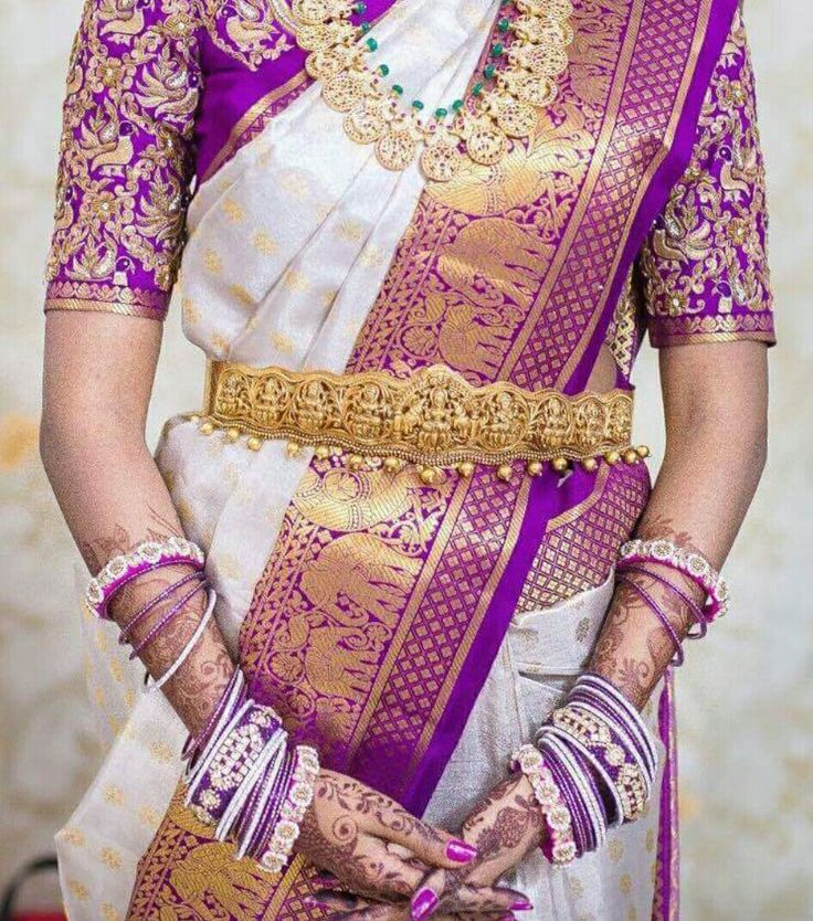 South Indian bride. Gold Indian bridal jewelry.Temple jewelry. Jhumkis.Purple and white silk kanchipuram sari.Braid with fresh jasmine flowers. Tamil bride. Telugu bride. Kannada bride. Hindu bride. Malayalee bride.Kerala bride.South Indian wedding.