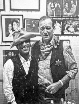 """For """"Sergeants 3"""" ('62) John Wayne generously loaned Sammy Davis Jr. his weathered hat he had worn in John Ford cavalry films and in """"Rio Bravo"""". Even with extra padding in the liner the hat still fit Davis loosely. By the time Wayne got the hat back the top front of the crown was badly worn and the hat was ready to be retired."""