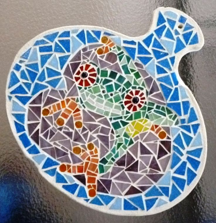 Mosaic frog wall hanging made for Donna. It was created on an old chopping board.