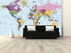 World Political Map Wall Mural in Room - This colorful world political wall map mural illustrates individual countries in contrasting colors making them easy to identify. Indicated on the map are major cities, national capitals, rivers, lakes, mountain peaks, U.S. state borders and Canadian provinces as well as latitude/longitude lines. The large wall mural size map is perfect for a home, office, public lobby, classroom, or even a kids room.
