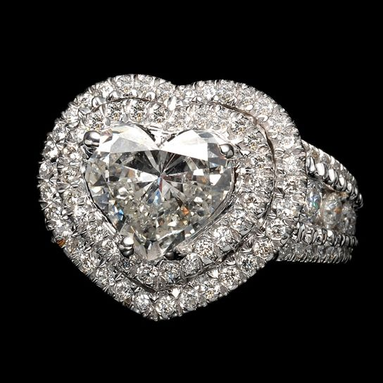"""STUNNING!!! White gold ring with 5 carat cut diamond """"heart"""", inlaid with white diamonds."""