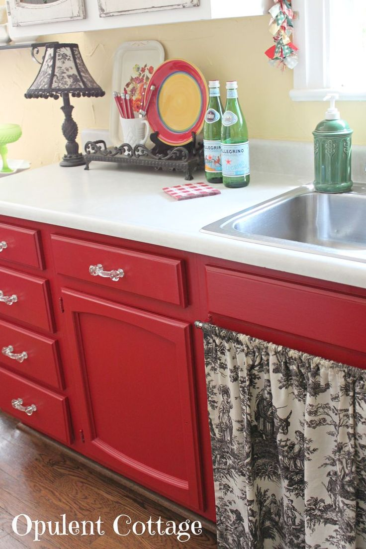 Red cabinets? Check. Black toile fabric. Check. Yellow walls (again)? Thinking. Fabric under sink and butler's pantry.....