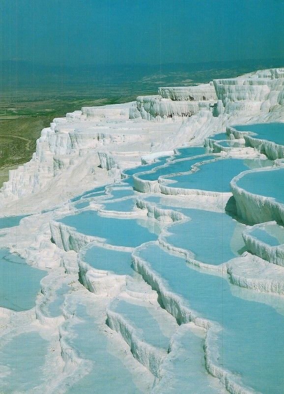 "Pamukkale, meaning ""cotton castle"" in Turkish, is a natural site in Denizli Province in southwestern Turkey. The city contains hot springs and travertines, terraces of carbonate minerals left by the flowing water. It is located in Turkey's Inner Aegean region, in the River Menderes valley."